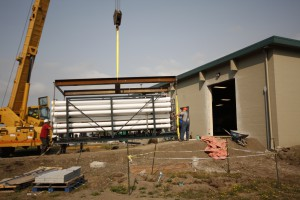 The full nanofiltration unit is lifted by a crane into the Water Treatment Plant August 22, 2014. The full filtration system is scheduled to be online by October 2014.