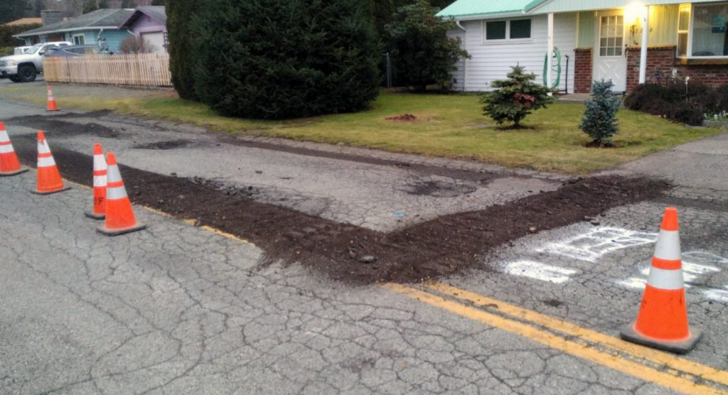 Prep work begins on damaged road sections